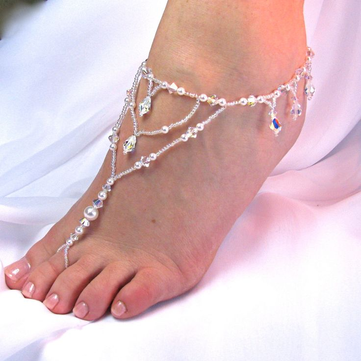 barefoot wedding sandals! HA! Found a way to go barefoot at my wedding :-) Now if only they made shoes that sink into the ground to make you shorter...