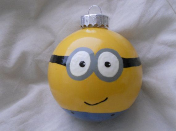 Despicable Me Minion Ornament I could DIY this! clear ornament, swirl around yellow inside then paint the rest on the outside! could do different combos! so cute