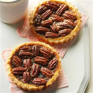 Maple Pecan Tarts Recipe -I absolutely love pecans. I combine them with maple and vanilla to create the ultimate tart, made even richer with a scoop of vanilla ice cream. —Redawna Kalynchuk, Barrhead, Alberta