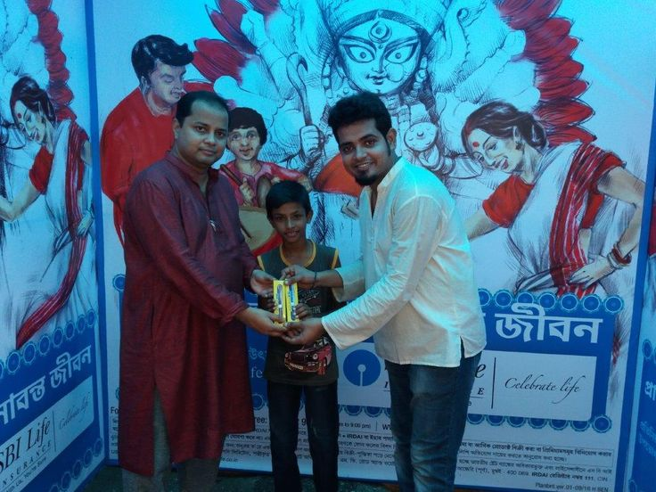 Felicitated by Emcee during SBI Life Durga Puja Resi Activity