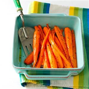 Roasted Carrots with Thyme Recipe -Cutting the carrots lengthwise makes this dish look extra pretty.—Deirdre Cox, Kansas City, Missouri