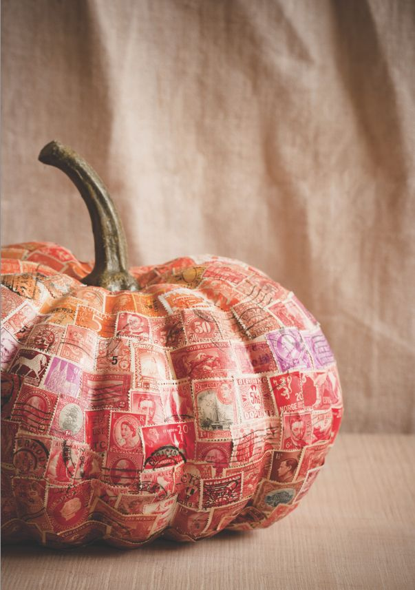 An incredible postage stamp decorated pumpkin.