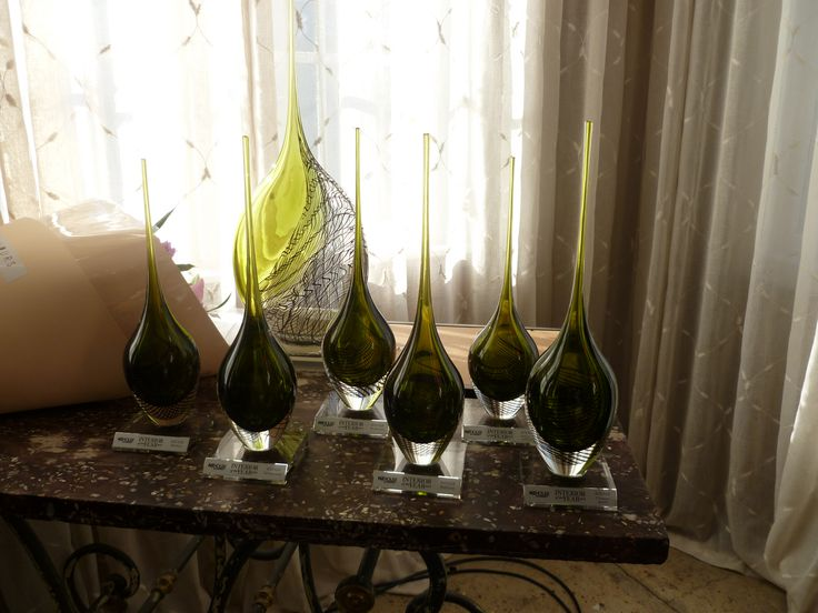 Trophies by glass artist Katie Brown and flowers for the winners — at James, Parnell.