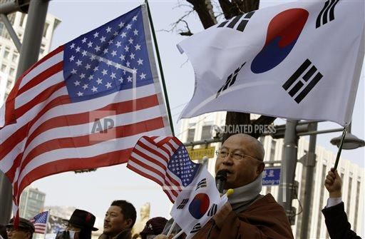 A South Korean Buddhist monk speaks during a rally wishing for a quick recovery of injured U.S. Ambassador Mark Lippert near the U.S. Embassy in Seoul, South Korea, Friday, March 6, 2015. Lippert struggled with pain as he recovered Friday from a knife attack, while police searched the offices of the anti-U.S. activist who they say slashed the envoy while screaming demands for Korean reunification. (AP Photo/Lee Jin-man)