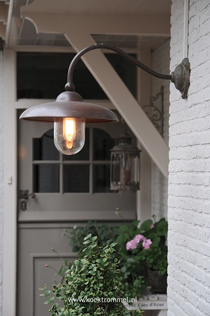 old barn light, vintage reproduction. Also love the color of the door