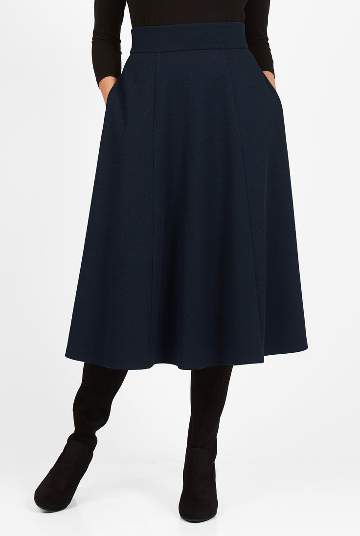 Our feminine skirt with flare is shaped from vertical panels of comfortable textured crepe jacquard knit.