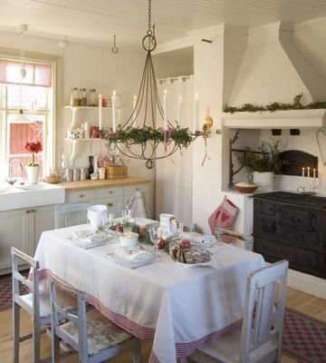 Lantlig jul i vitt och rött....this old fashioned swedish kitchen is how my mum styled ours