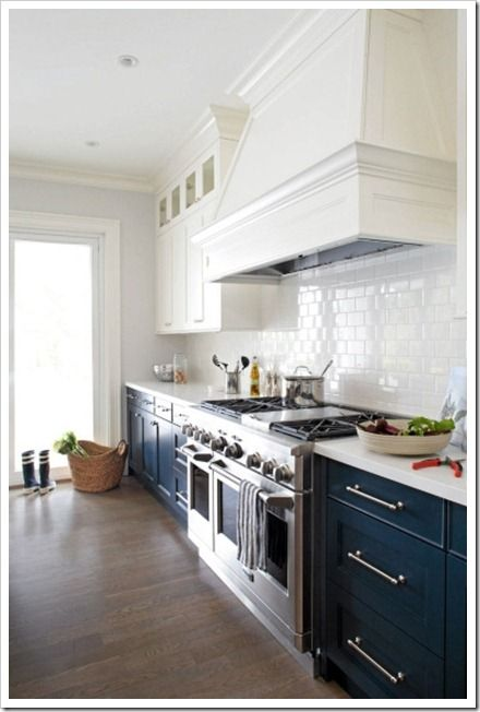 I sooo love this bright two tone kitchen. I can't tell if the lowers are black or blue. but I'm going to imagine their inky blue. beautiful!