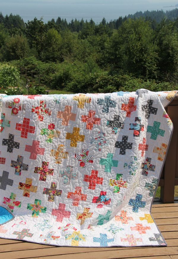 Since this quilt lives at Grandma's house…Jane and I took photos in her beautiful garden on the most beautiful day!  My Mom made this with strips cut from her floral fabrics, and used…