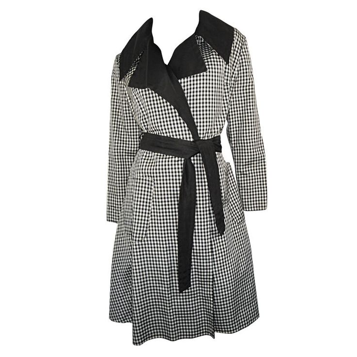 The raincoats black and white dress
