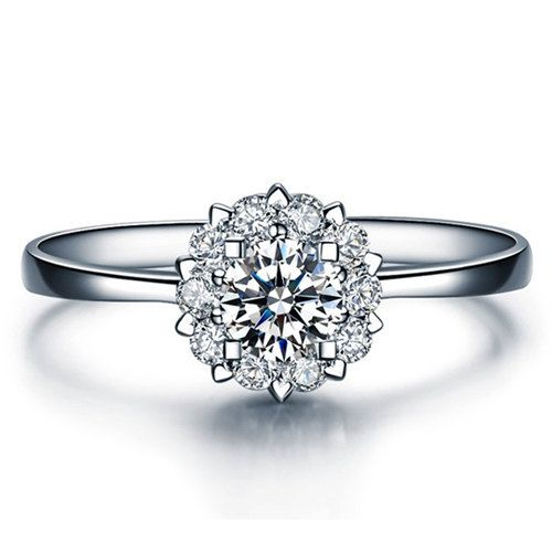 This cluster diamond engagement ring comes with a beautiful natural, white and sparkling round cut center diamond that was clarity enhanced to