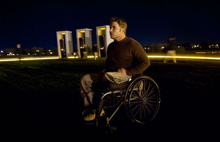 In the early morning hours of Wednesday Nov. 18, 2009, on the 10th anniversary of the 1999 Aggie Bonfire collapse John Comstock lingers after most have left at the Aggie Bonfire Memorial on the Texas A campus in College Station.