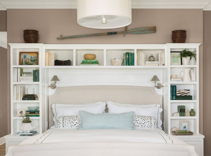 Creamy neutral walls enhance a beautiful storage headboard by complementing the decorative items and echoing the hue of the enclosed fabric headboard. Shown here: Pratt & Lambert Sea Hawk 33-26