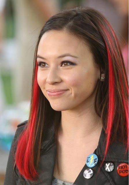 Malese Jow dark hair. Bright red streaks