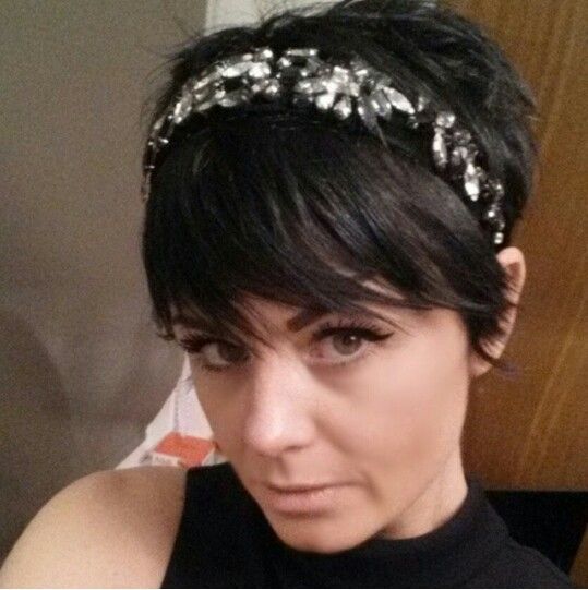 short hair. Pixie, headband, makeup.