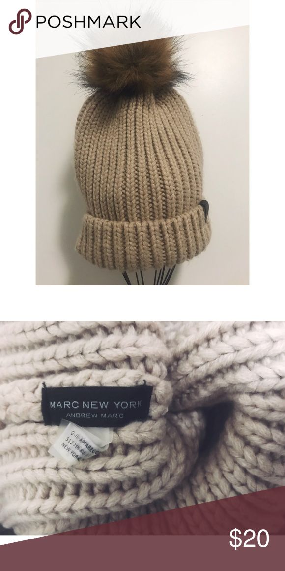 Andrew Marc Wool Beanie Knitted wool beanie. Very good condition. Subtle makeup stain on the inside (have not tried cleaning). Perfect for winter! Andrew Marc Accessories Hats