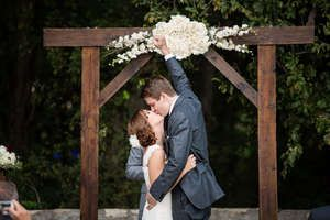 simple wooden arch with a floral spray