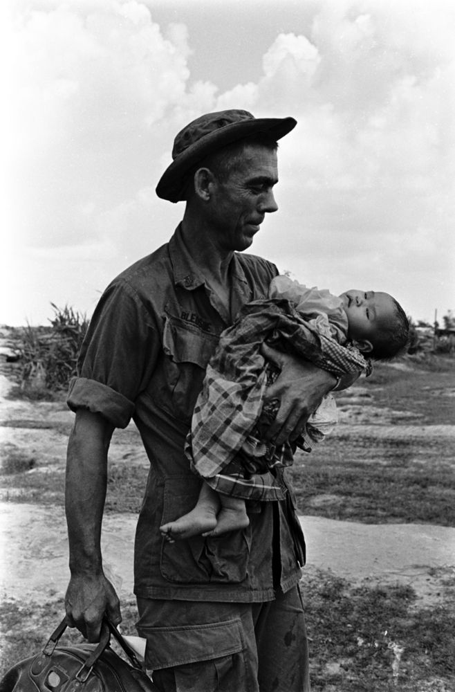 Staff Segeant Edgar D. Bledsoe, of Olive Branch, Ill., carries a critically ill Vietnamese infant who was brought to Fire Support Base Pershing. Photo first published 1968. Charlie Haughey was drafted at 24 in 1967 and from March 1968 until May 1969, Haughey established an archive of more than 2,000 negatives, documenting the struggles of his brothers in arms. Photos rediscovered 2012.