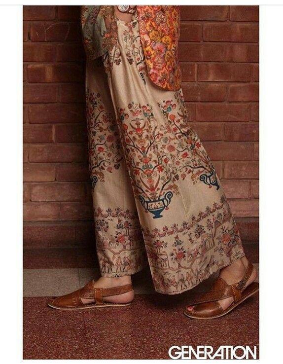 Embroidered trousers by Pakistani high street brand Generation. Leather sandals are traditional Pakistani Peshawari chappal.