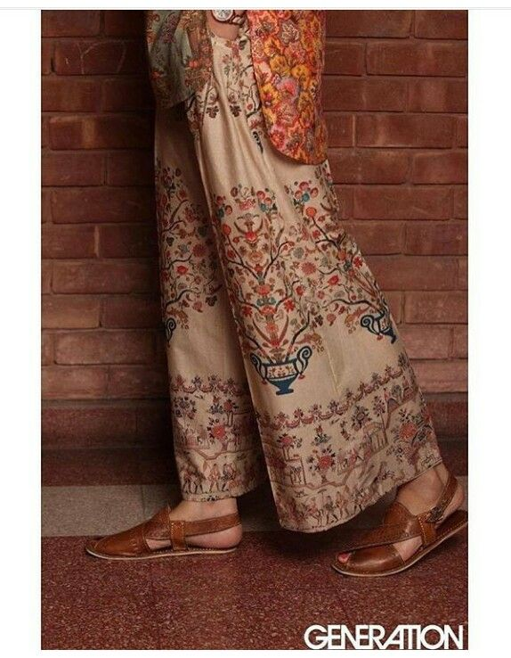 Embroidered trousers by Pakistani high street brand Generation. Leather sandals are traditional Pakistani Peshawari chappal.