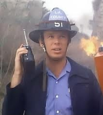 Kevin Tighe as Roy Desoto in the field fighting a fire.