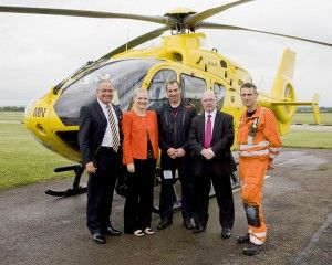 1st July 2013 - Local MP, Alistair Burt (2nd from right) praised the work of the East Anglian Air Ambulance after he visited their base at Cambridge Airport to find out more about the life-saving service.