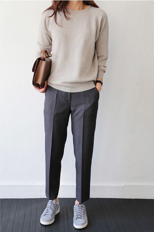 Trousers, simple sneakers, plain sweater, clean bag/clutch                                                                                                                                                      More