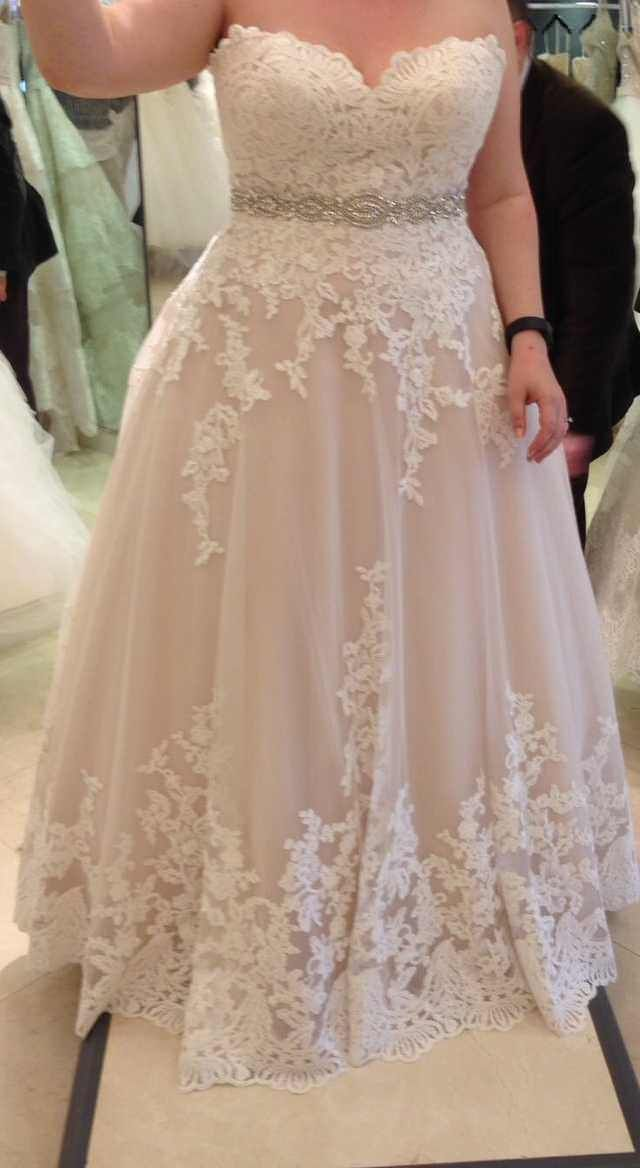 I may have found my wedding dress but the tag was cut out. Can anyone help identify this dress??