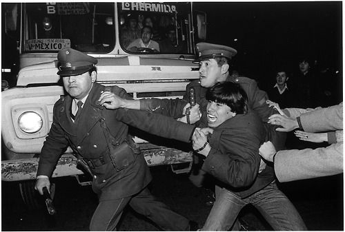 by Alvaro Hoppe Arrest following flash demonstration for the release of political prisoners, Santiago, 1986.