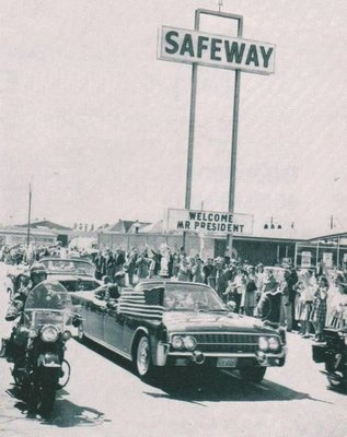 President Kennedy visible in the back of his limousine at the Safeway grocery store located at 3707 Lemmon Ave. in Dallas.