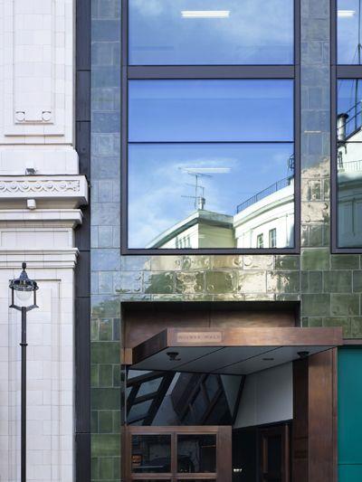 Green glazed brick and slick windows