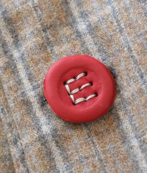 Make your own buttons from polymer clay. A nine-hole button can be stitched with any letter of the alphabet.