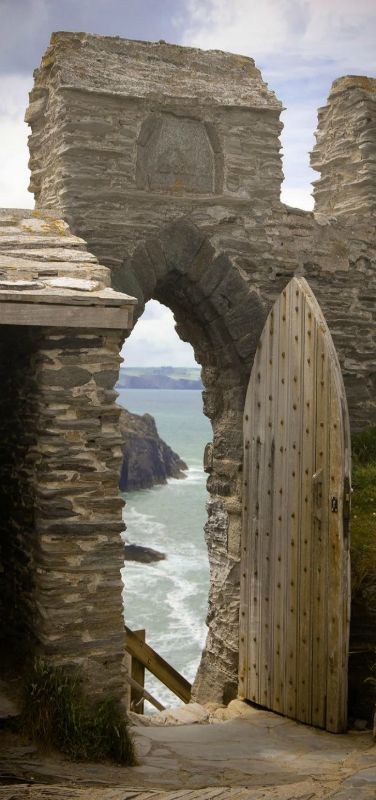 The old walls and doors of Tintagel Castle. The birthplace of King Arthur, England | Rock Ruin by the sea | by Vincent Hoogendoorn