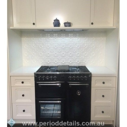 Shoji White powdercoat is the perfect colour for the Original Pressed Tin Panel splashback in this Kitchen nook.