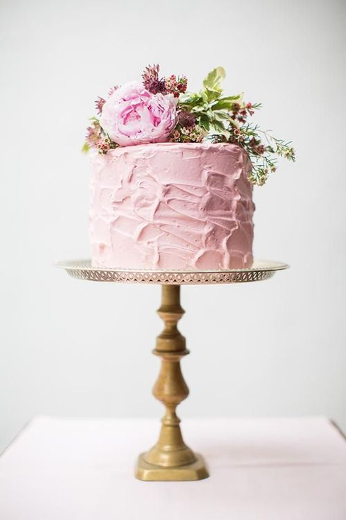 small wedding cake. love the textured frosting & flowers on top.