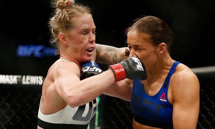Referee Todd Anderson's controversial decision not to take a point from Germaine de Randamie during her bout Saturday at the Barclays Center in Brooklyn against Holly Holm led directly to the Dutch woman capturing the first women's featherweight title in the main event of UFC 208.  Judges Chris Lee,