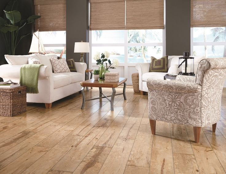 "The natural and organic look of hardwood is a very popular style, and that essence is perfectly captured by Riverside by Mannington. Both serene and stylish, Riverside embodies the natural appeal of a birch. Pairing its light color and wide plank width (8""), Riverside is the perfect finish to brighten up any living area.  Available in Natural (shown here), Pearl and Oyster shades. Riverside also features a new, glossy finish inspired by high-end European wax finishes."