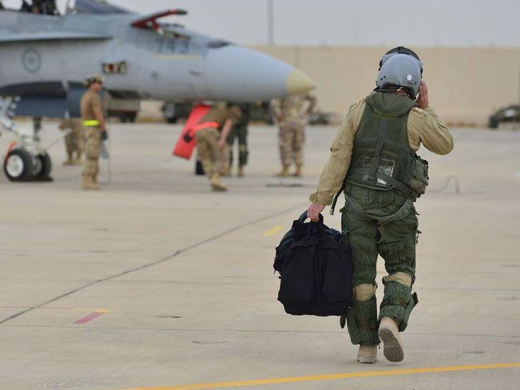 A Royal Canadian Air Force CF-18 Fighter pilot walks down the flight line in Kuwait after his first combat mission over Iraq in support of Operation IMPACT on October 30, 2014. Photo: Canadian Forces Combat Camera, DND Un pilote de chasseur CF18 de l'Aviation royale canadienne traverse l'aire de trafic, au Koweït, après avoir participé à la première mission de combat en Irak à l'appui de l'opération IMPACT, le 30 octobre 2014. Photo : Caméra de combat des Forces canadiennes, MDN ...