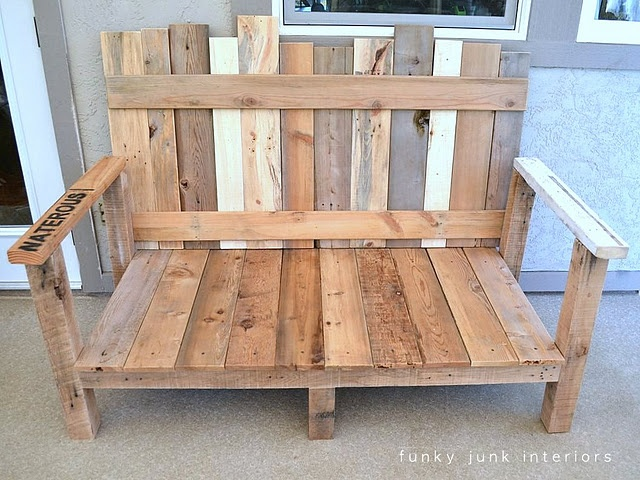 Made out of old pallets!  Add a cushion and some pillows and this would look adorable on our new patio!