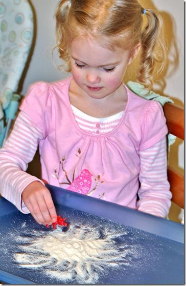 Draw and explore with cornmeal - a fun sensory activity that is safe for even the youngest children!