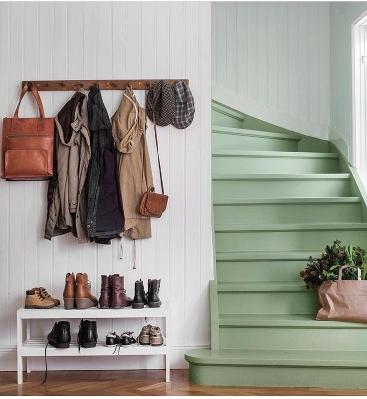 Entryway with mint green stairs