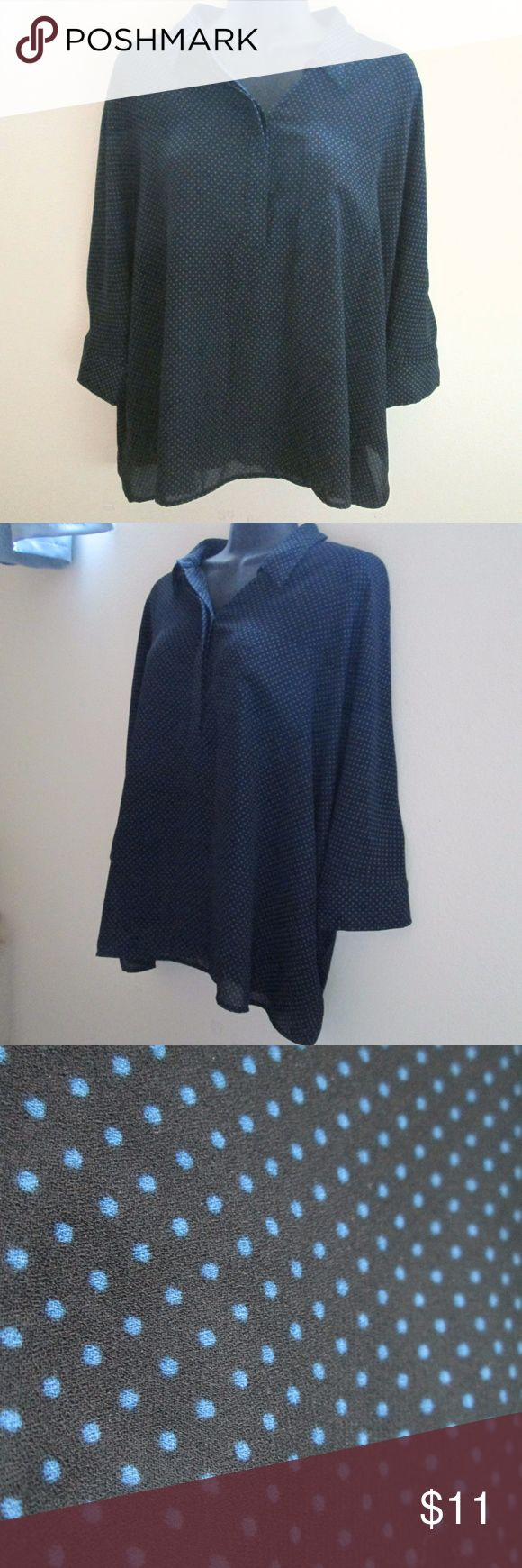 "Ann Taylor LOFT Oversized Polka Dot Blouse Excellent condition - no holes, stains or rips. Black with blue polka dots. Oversize/slouchy fit. Dolman sleeves. Measures 28"" across the bust (lying flat) and 25"" from the top of the shoulder to the bottom of the hem. Comes from a smoke-free home.  No trades. No holds. LOFT Tops Blouses"
