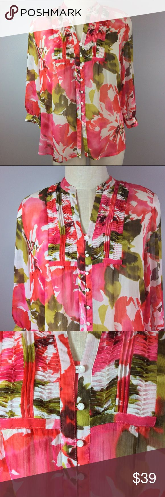 """Jones New York Signature Floral Blouse Size L/XL Jones New York Signature Floral Blouse Size L/XL.  Beautiful pink, red, green floral design.  Long and flowy.  Ruching with in insert. Blouse is sheer so I recommend a nude cami underneath.  Pretty pearlized buttons. EUC. Runs large imo. Measures 23"""" flat under arms.  28"""" long with 20"""" sleeves. My mannequin measures 40"""" across bust and this Blouse fits loosely. Jones New York Tops Blouses"""