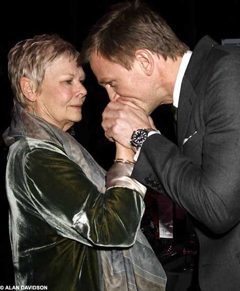 A kiss for M: Daniel Craig puckers up to Bond boss Judi Dench...... oh and now that Bond boss is dead... the 2013/2014 next Bond will be so good.....