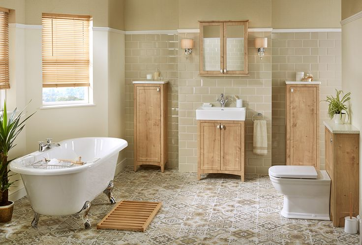 A calm, restful bathroom in the natural tones of eton oak with a classic washbasin unit flanked by twin tall bathroom cabinets to provide plenty of bathroom storage space #downton #downtonshaker #bathroomfurniture #myutopia