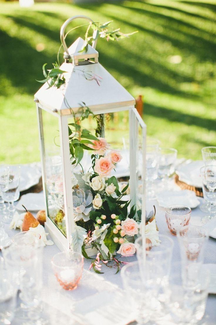 Chic centerpiece with a lantern and pretty little blooms inside #wedding #centerpiece #gardenparty #tablescape #weddingdecor