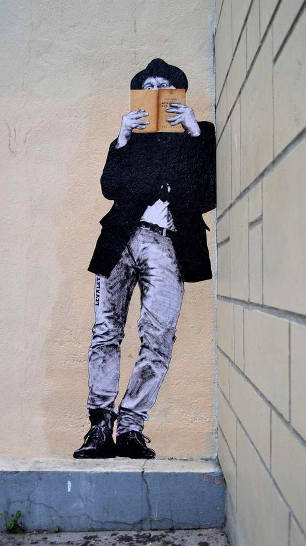 Street art by French artist Levalet. Collages made of India ink on white kraft paper with addition of real books to some.