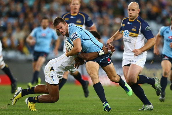 Rob Horne of the Waratahs is tackled during the round 14 Super Rugby match between the Waratahs and the Brumbies at ANZ Stadium on May 18, 2013 in Sydney, Australia.