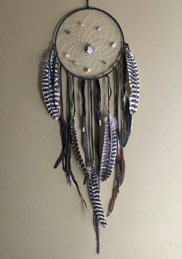 Created with love as a protective talisman for your home. This large dream catcher is adorned with black deerskin, crystals and wild pheasant and turkey feathers. The 12 inch diameter hoop is woven wi