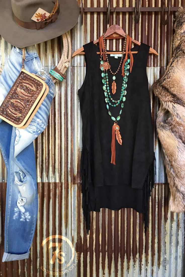 - Faux suede black fringe tunic - Sleeveless - Hi-lo hem - Split sides with fringe - Super soft and so comfy - Shown styled with The Kadoka vest, The Crowley Clutch, Walhalla Necklace, Raylen Necklace